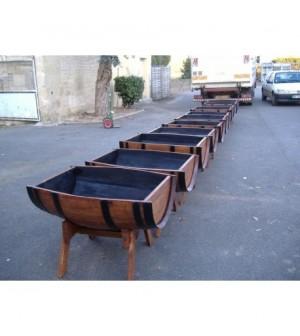 Bac à fleurs modele bateau sur chevalet en chêne 110l